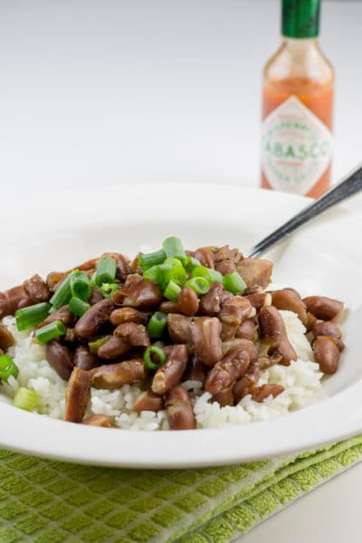 Delicious spicy red beans and rice with andouille sausage. This recipe's the perfect portion for two! It makes two big dinner-sized servings, plus two lunch-sized portions for leftovers.