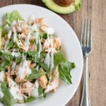 Grilled Salmon salad with avocado and ranch dressing. The perfect way to use up leftover grilled salmon!