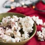 Holly Jolly Peppermint Popcorn | Popcorn covered in vanilla almond bark, crushed candy cane and chocolate.