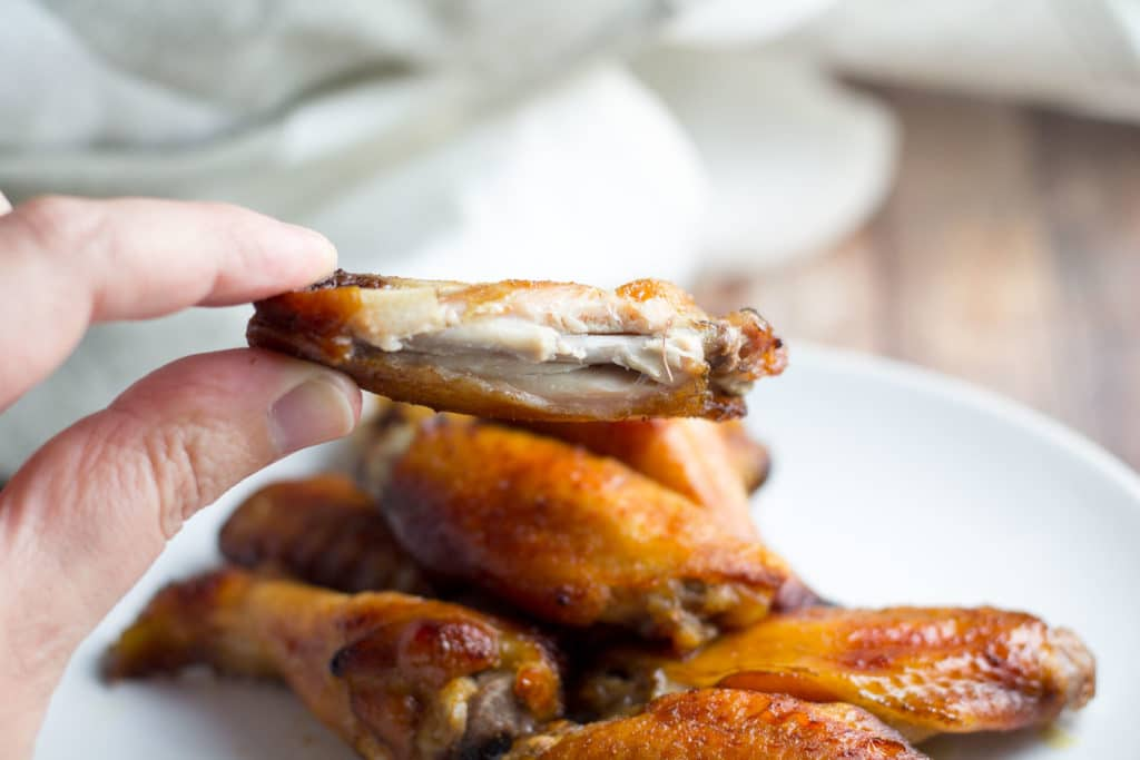 Asian Chicken Wing with a bite taken out of it