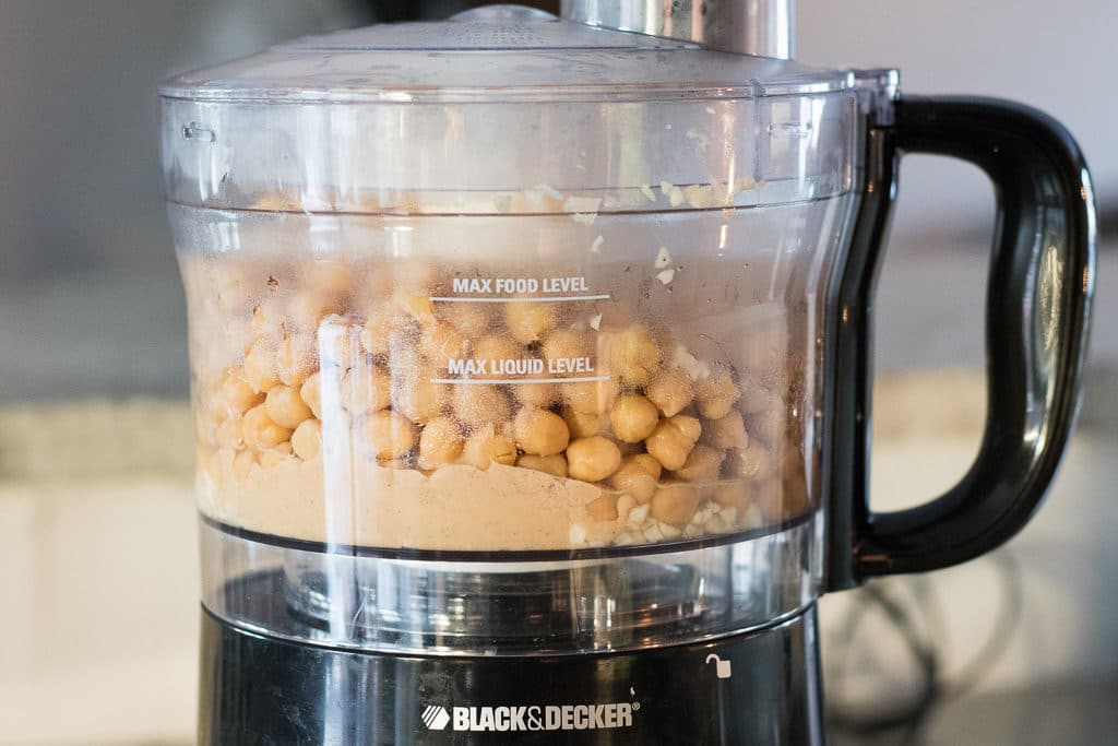 ingredients for hummus in a food processor