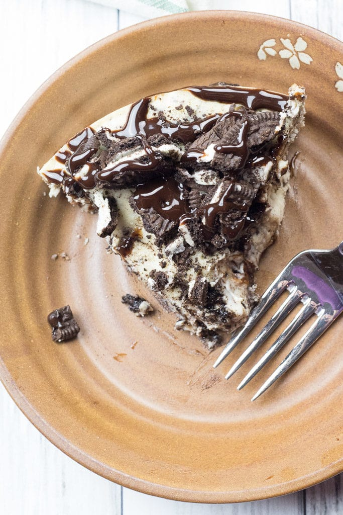 slice of instant pot oreo cheesecake on a plate