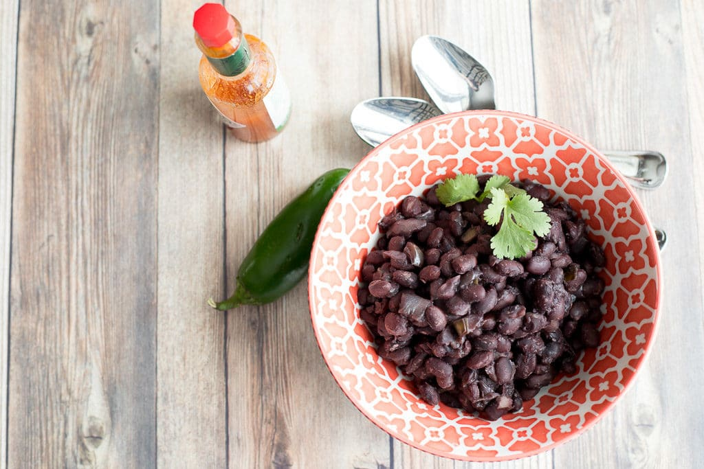 bowl of instant pot black beans on a table